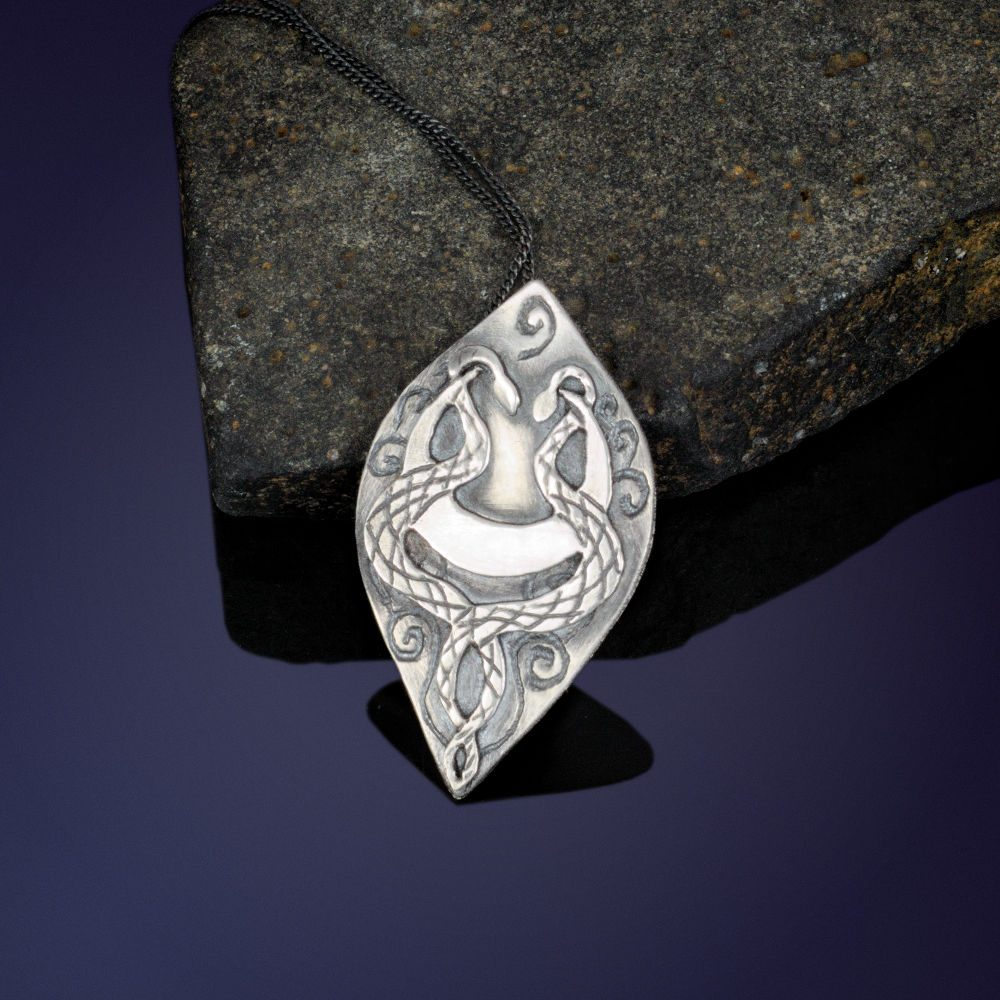 Sterling silver intertwined snakes pendant
