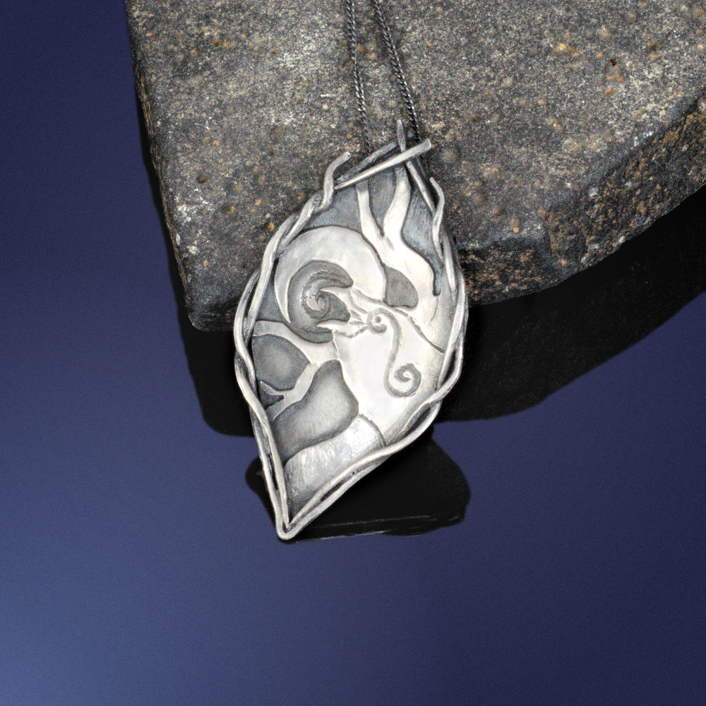 Sterling silver raven pendant, featuring a crescent moon, a tree, and a calling raven