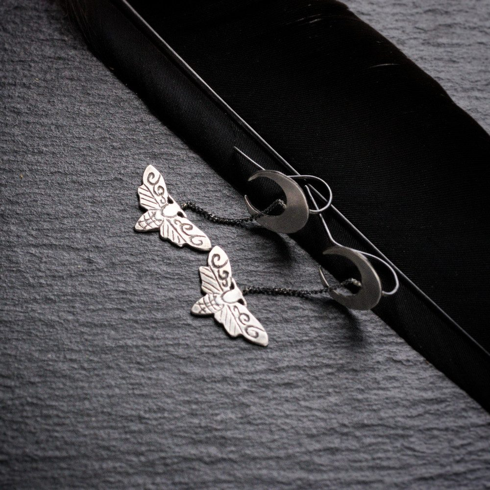 silver crescent moons and death head moth earrings