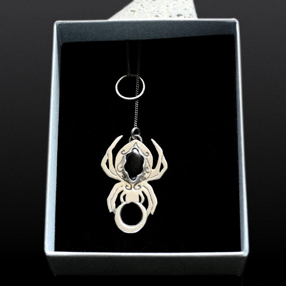 spider choker necklace shown in a box