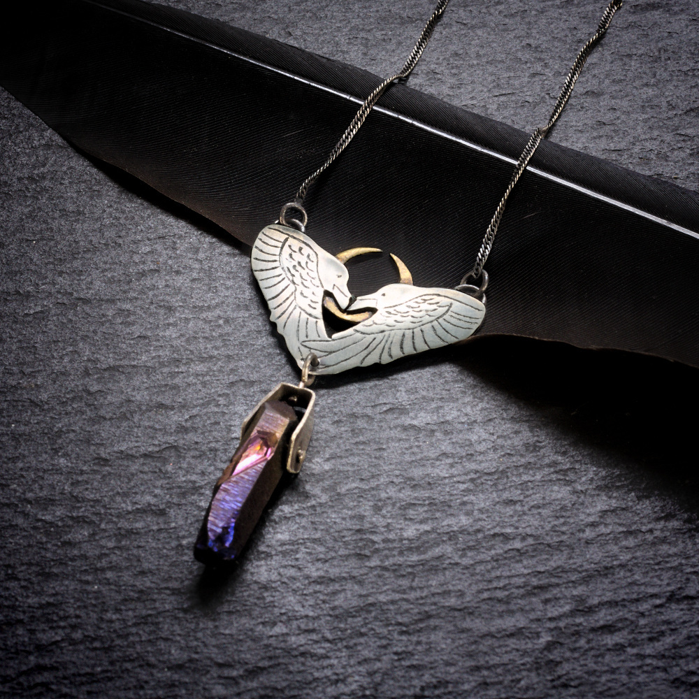 Sterling silver two ravens necklace with titanium coated quartz crystal