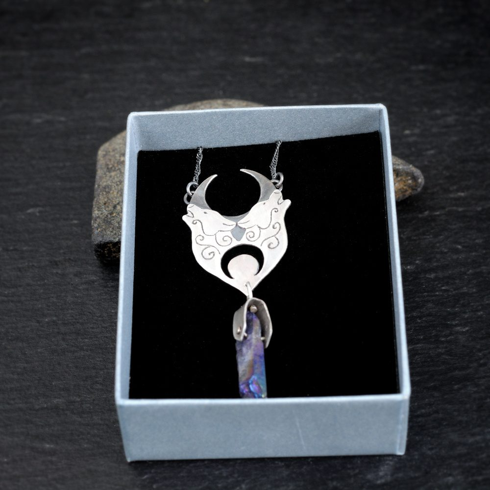 Sterling silver howling wolf necklace with titanium coated quartz crystal in a box