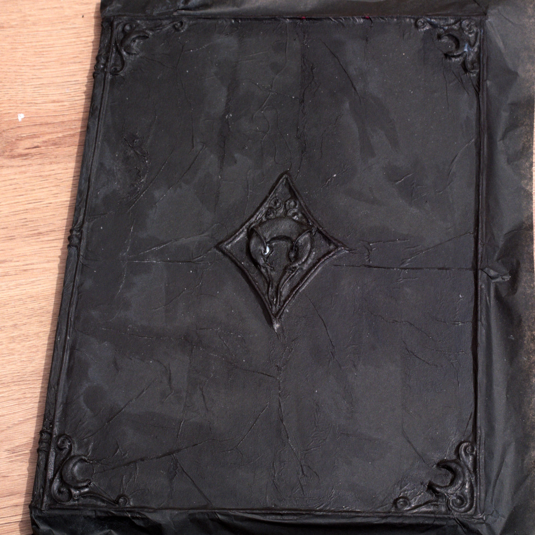 front cover of the sketchbook with the first layer of tissue paper done. witchy journal DIY